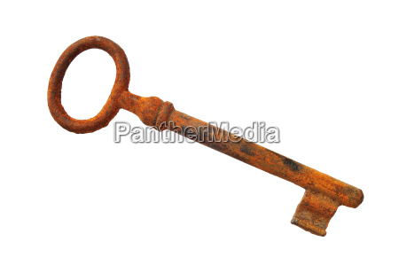 old rusty key isolated on white