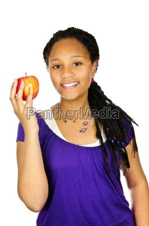 girl holding apple