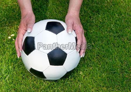 frau mit fussball lady with