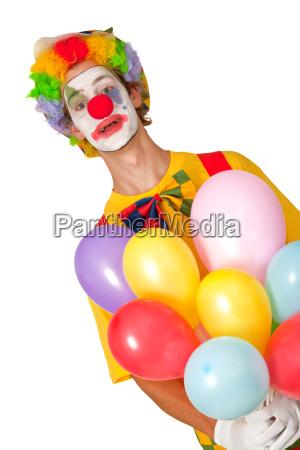 bunter clown mit luftballons