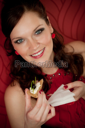 cocktail party woman eat appetizer evening