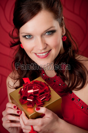 cocktail party woman hold present evening