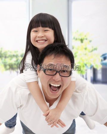 happy asian family father and little