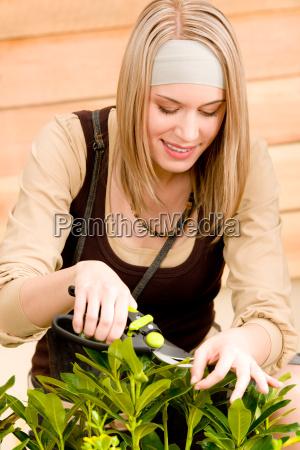 gardening woman pruning plants in spring