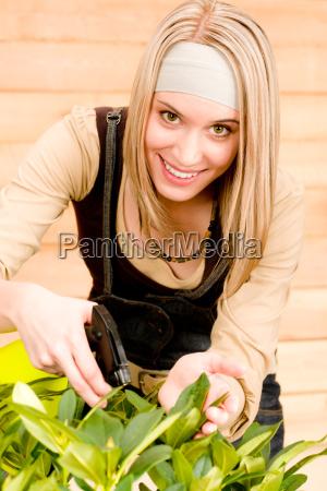 gardening woman watering plants in spring