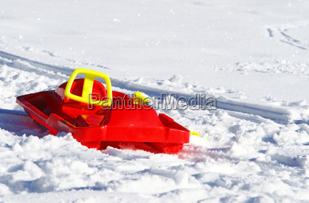red sled in snow