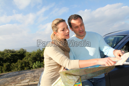 couple looking at road map on