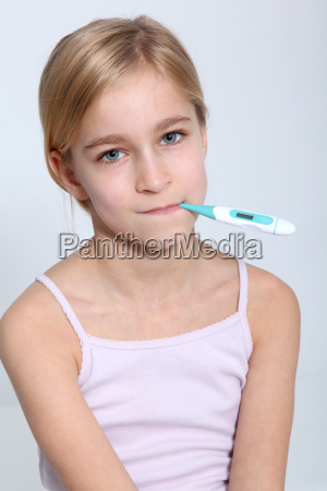 portrait of little girl with thermometer