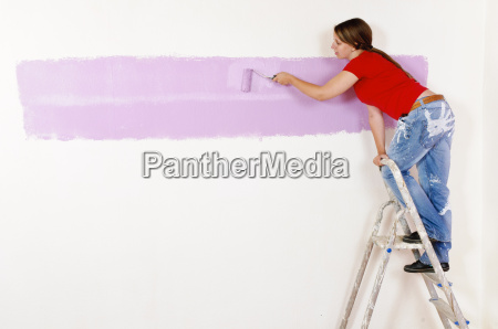young woman strokes a wall