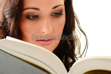 young famele reading a book isolated