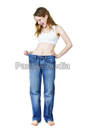 happy girl in jeans after losing