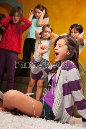 little girl sings out loud