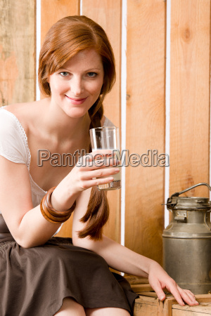 young woman drink natural milk country