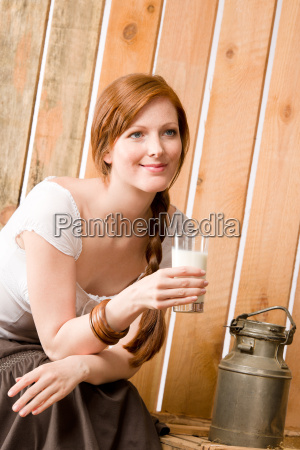 young woman drink natural milk in