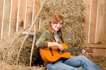 young country woman play guitar