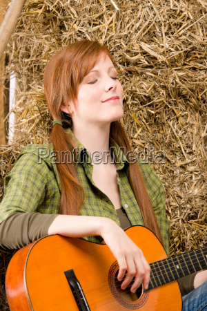 young country woman relax with guitar
