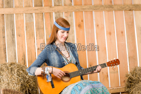 young hippie woman play guitar in