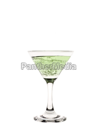 a cocktail glass with green liquid