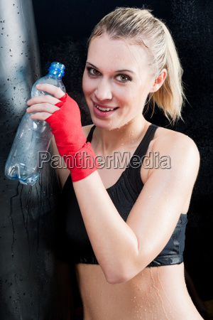 boxing training woman drink water