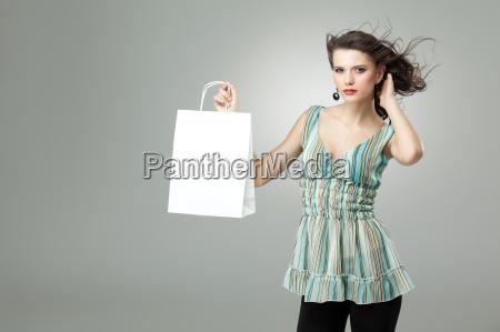 brunette holding shopping bag