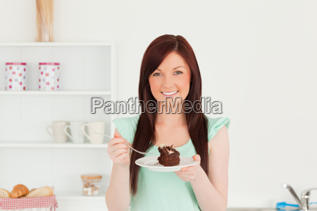 good looking red haired woman eating