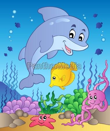 happy dolphin at sea bottom 1