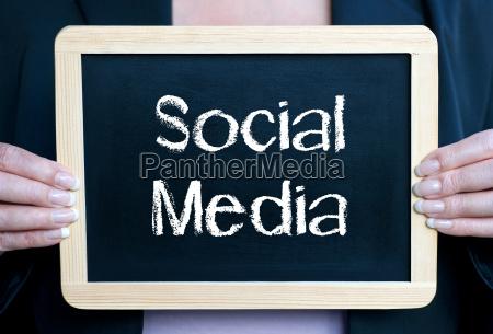 social media woman with chalkboard