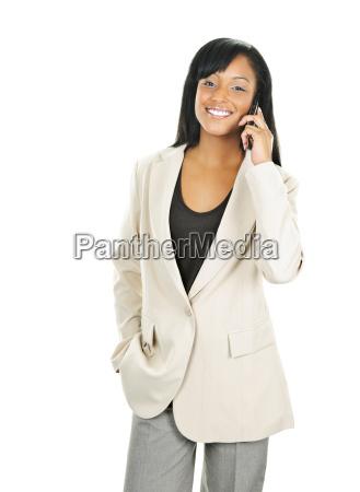 smiling black businesswoman on phone