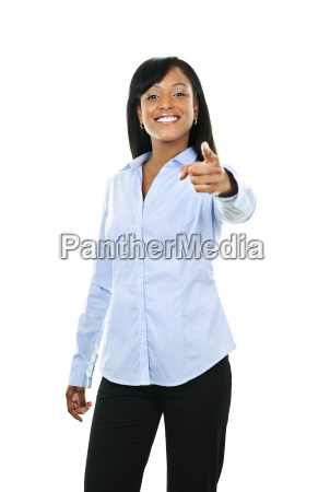smiling young woman pointing finger forward