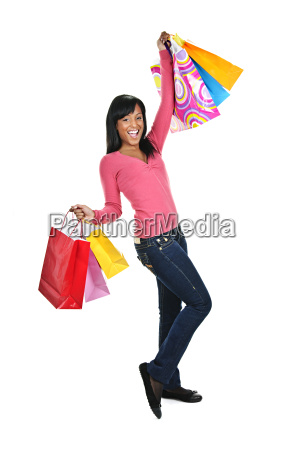 excited young black woman with shopping