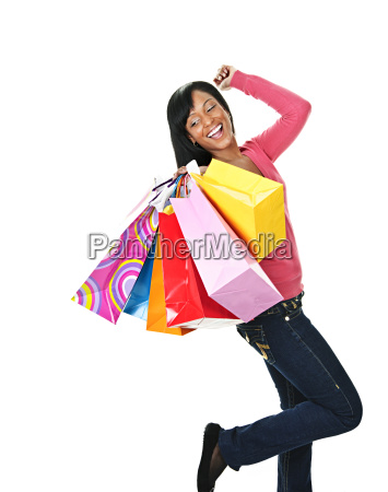 young excited black woman with shopping