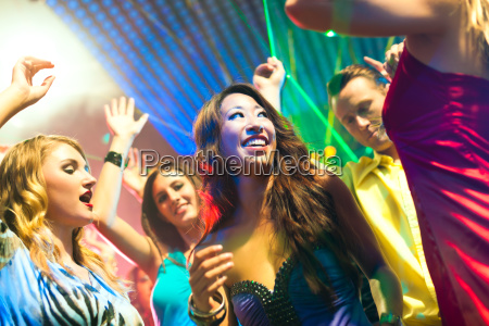 people at party in disco club