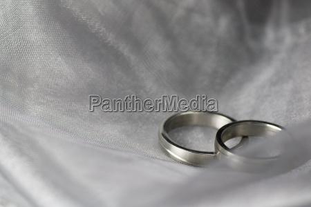 wedding rings and silk