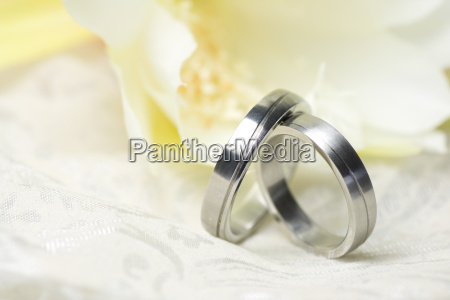 wedding rings and yellow flower