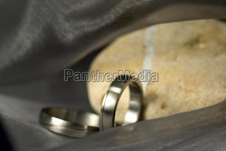 wedding rings on dark silk