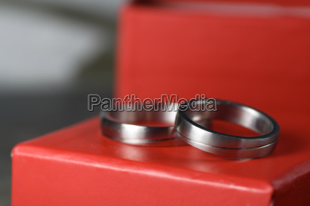 wedding rings on red gift
