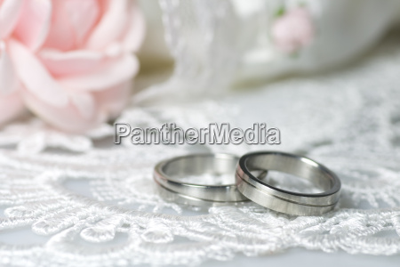wedding rings on romantic background