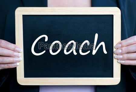 coach with chalk blackboard
