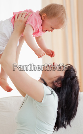 cute woman holding her baby in