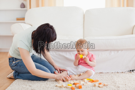 attractive woman playing with her baby