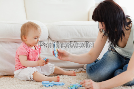 beautiful woman and her baby playing
