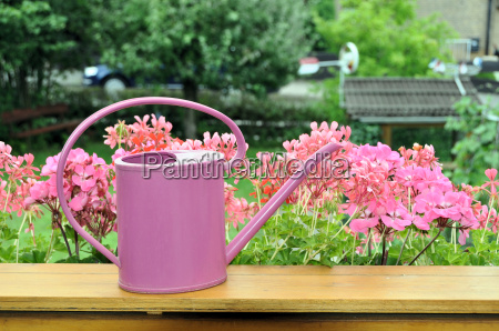 watering can on the balcony