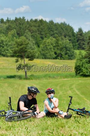 sport mountain biking couple relax in