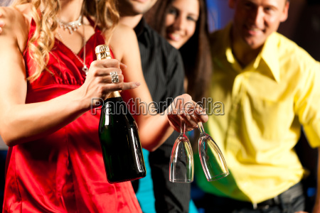 people with drinks in bar or