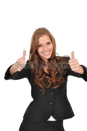 geschaeftsfrau im anzug mit zwei daumen