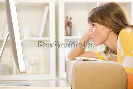 woman at home with computer