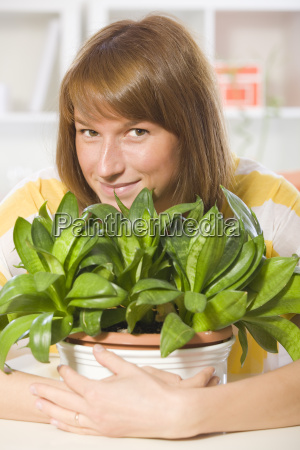 happy woman with plants
