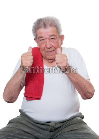 sporty senior raises both thumbs