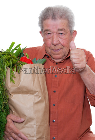 senior carrying a shopping bag