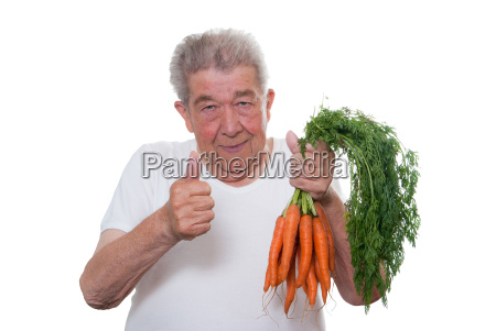 senior with carrots in hand